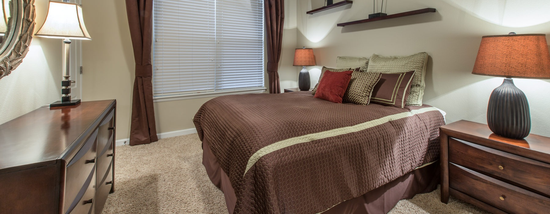 Well lit bedroom with large windows for natural light and a queen size bedroom